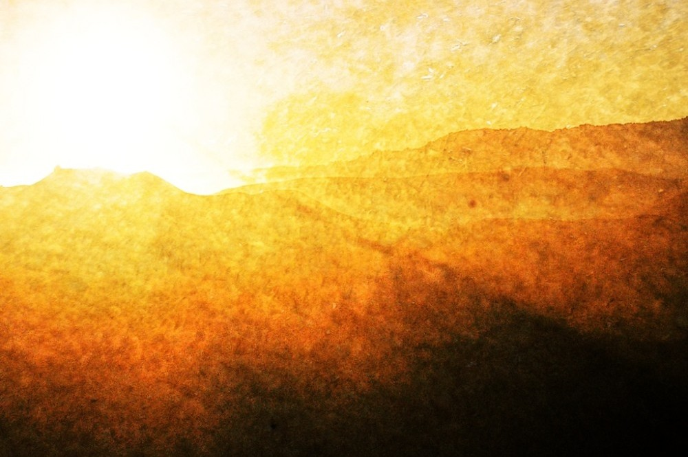 textured bright sun over the mountains